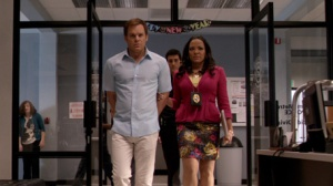 Dexter in bracelets, LaGuerta natural pOlice...would it last? No.