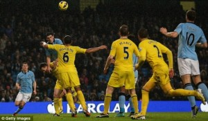 Gareth Barry somehow hangs in the air long enough to head in City's winner against Reading