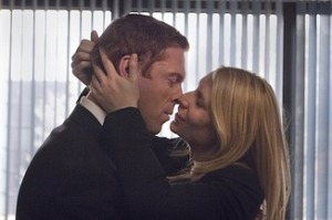 Carrie takes time out from pinning pictures onto boards to make out with a a suspect