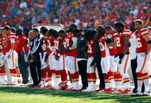 The Chiefs take a moment of silence before their game against the Panthers