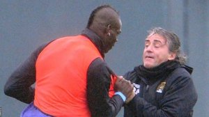 Balotelli and Mancini grapple during training