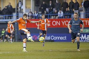 Alex Lawless scores the goal the secures a win for non-league Luton Town against Wolves