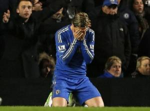 Chelsea fans try to say something to Torres, but he misses that as well