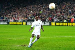 Adebayor puts his penalty exactly where every Spurs fan knew he would, row z