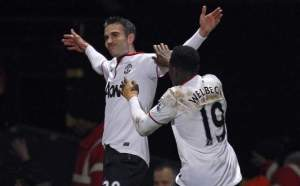 Robin Van Persie celebrates his second goal in two matches - one a penalty, the other offside