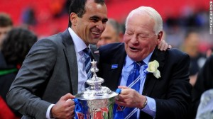 Roberto Martinez and Dave Whelan celebrate the Cup win before the relegation storm
