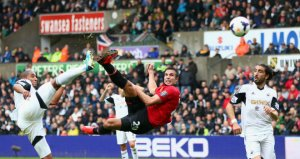 Robin Van Persie opens the scoring against Swansea last Saturday