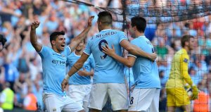 Aguero celebrates his second and City's third goal against United