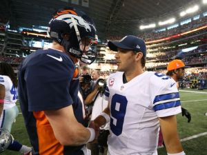 Romo and Manning share a handshake after their two teams put up 99 combined points