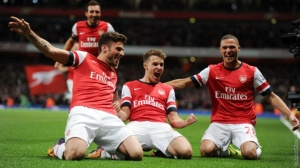 Aaron Ramsey celebrates his goal against Liverpool with Giroud and Gibbs