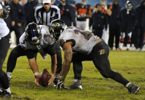 Joe Flacco and the Ravens struggle to control the ball in a muddy Chicago