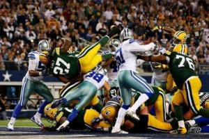 Eddie Lacy dives in for the winning score for the Packers over the Cowboys