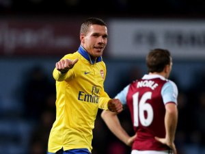 Podolski returned from injury to propel Arsenal to victory at West Ham