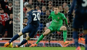 Robin Van Persie fails to convert an early chance against his old club