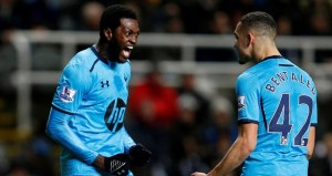 In-form Adebayor celebrates his first goal against Newcastle with the provider, Nabil Bentaleb