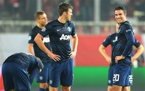 Distraught United players in Greece…and Robin Van Persie