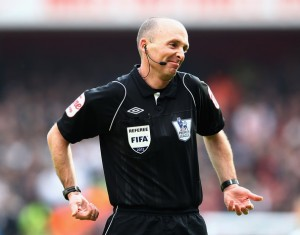 The man we all want to watch in a football match, referee Mike Dean
