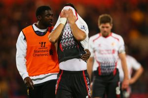 Kolo Toure reminds a crying Suarez that it was his mistakes that costs Liverpool the title