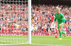 Welbeck and Hart look on as the Arsenal striker's lobbed effort comes back off the post