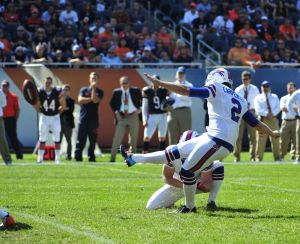 Dan Carpenter of the Bills kicks the winning field goal against the Bears