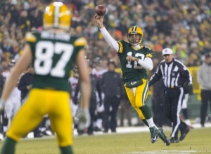 Rodgers throws a touchdown pass to Jordy Nelson on Monday night as the Packers stayed perfect at home in 2014