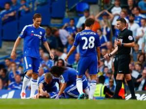 Why did the Chelsea medical staff go onto the pitch to help a player who is lying down with a hand over his face?!